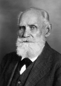 Black and white image of Ivan Pavlov - elderly man with white beard dressed in suit
