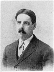 Black and white image of Edward Lee Thorndike - white man with mustache and wearing a suit