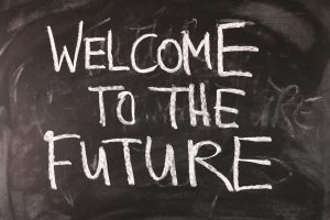 Chalkboard with the words 'welcome to the future' written on it