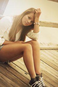 Somber teenage girl