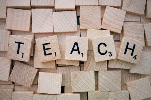 Scrabble words spelling the word 'teach'