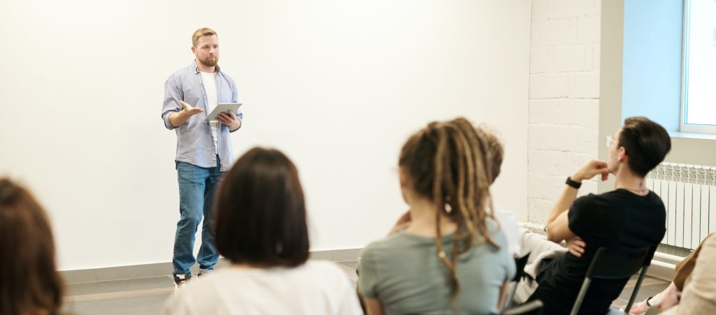 Man speaking in front of class