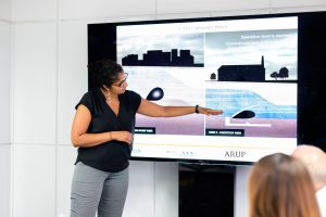 Woman presenting a Powerpoint presentation
