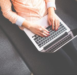 Photo of woman's hands on laptop