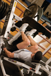 Photo of man doing leg presses